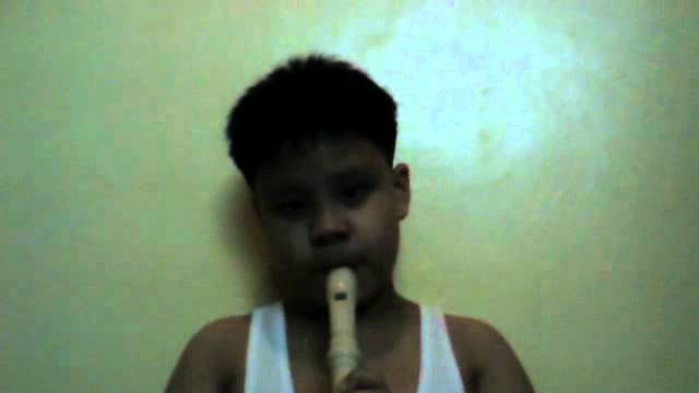 Coco playing the Recorder